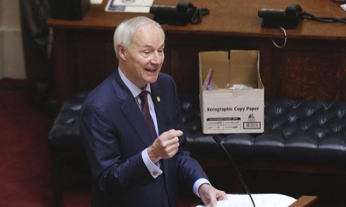 Arkansas Gov. Asa Hutchinson in the Senate Chamber of the state Capitol in Little Rock, Ark., on April 8, 2020. (Tommy Metthe/Arkansas Democrat-Gazette via AP)