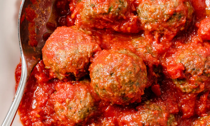 Adding pesto gives these meatballs a big boost of flavor. Will you have them on pasta or on a sub roll? (America's Test Kitchen/TNS)