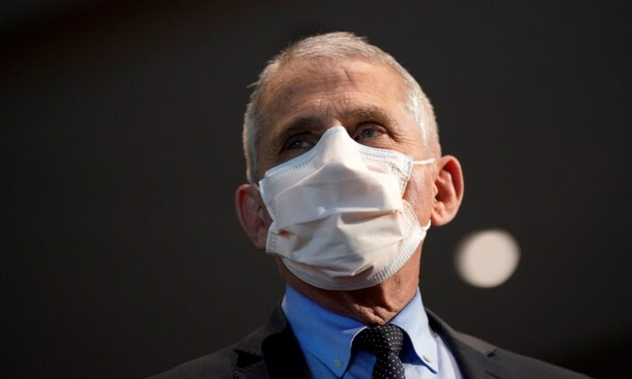 Dr. Anthony Fauci, director of the National Institute of Allergy and Infectious Diseases, is seen before receiving his first dose of the Moderna COVID-19 vaccine at the National Institutes of Health, in Bethesda, Md., on Dec. 22, 2020. (Patrick Semansky/Pool via Reuters)