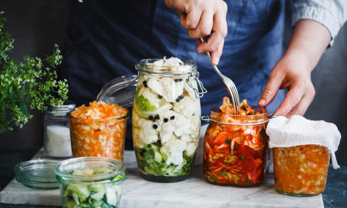 Fermented foods sup- port our microbiome.(casanisa/Shutterstock)