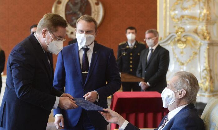 Czech president Milos Zeman (R) appoints Petr Arenberger (L) as the new Czech health minister in Prague, Czech Republic, on April 7, 2021. (Roman Vondrous/CTK via AP)