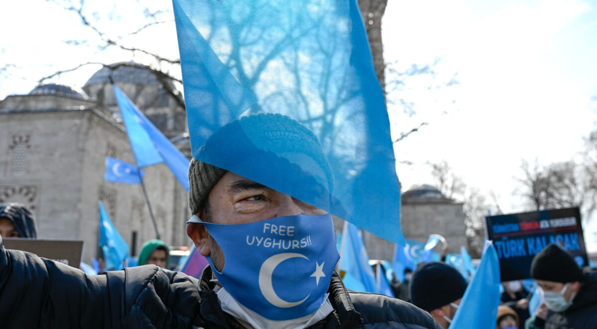 A protester from the Uyghur community