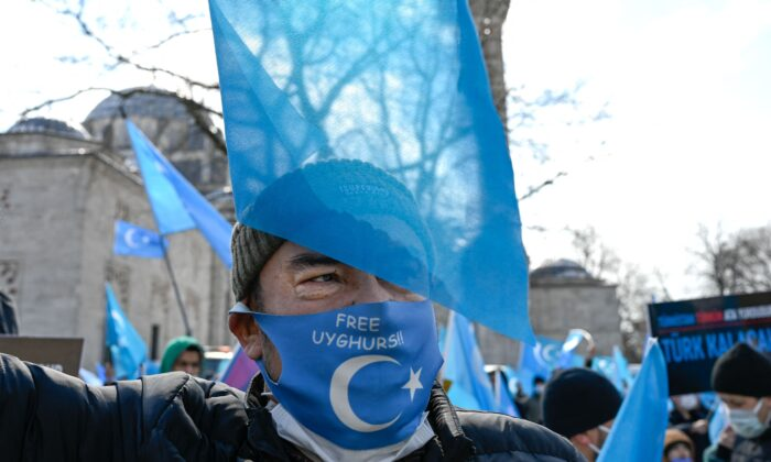 A protester from the Uyghur community living in Turkey attends a protest against the visit of China's Foreign Minister to Turkey, in Istanbul on March 25, 2021. (Bulent Kilic/AFP via Getty Images)