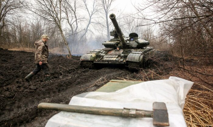 Ukrainian servicemen work on their tank close to the front line with Russian-backed separatists near Lysychansk, Lugansk region, on April 7, 2021. (STR/AFP via Getty Images)
