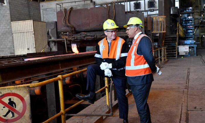 Australian Opposition Leader Bill Shorten (L) is seen talking to Liberty OneSteel owner Sanjeev Gupta (R) at the steel works in Whyalla in South Australia, May 1, 2019. (AAP Image/Darren England)