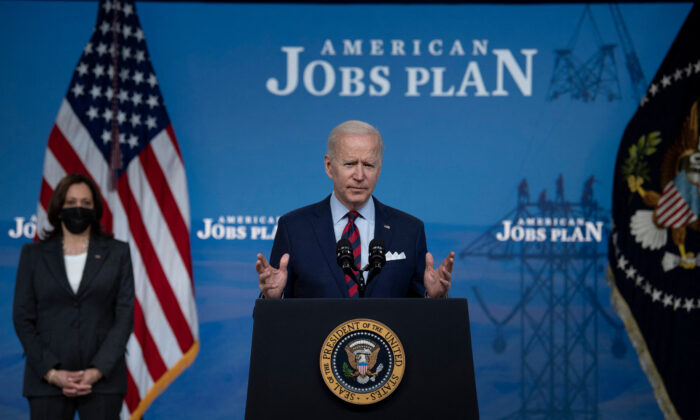 President Joe Biden, with Vice President Kamala Harris, speaks about infrastructure investment from the Eisenhower Executive Office Building on the White House campus in Washington on April 7, 2021. (Brendan Smialowski/AFP via Getty Images)