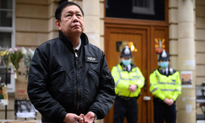 Former Burmese Ambassador to the UK Kyaw Zwar Minn listens to a statement being read on his behalf as he stands outside the Burmese Embassy in London on April 8, 2021. (Leon Neal/Getty Images)