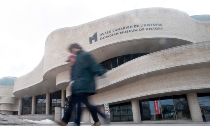 People walk past the Museum of History on March 14, 2020 in Gatineau, Que. The museum was one of many public spaces that closed its doors due to COVID-19. (Adrian Wyld/The Canadian Press)