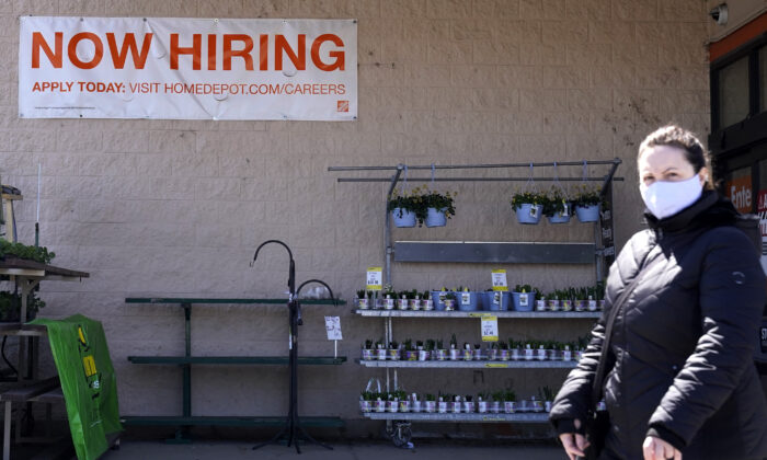 A hiring sign is seen outside a home improvement store in Mount Prospect, Ill., on April 2, 2021.  (Nam Y. Huh/AP Photo)
