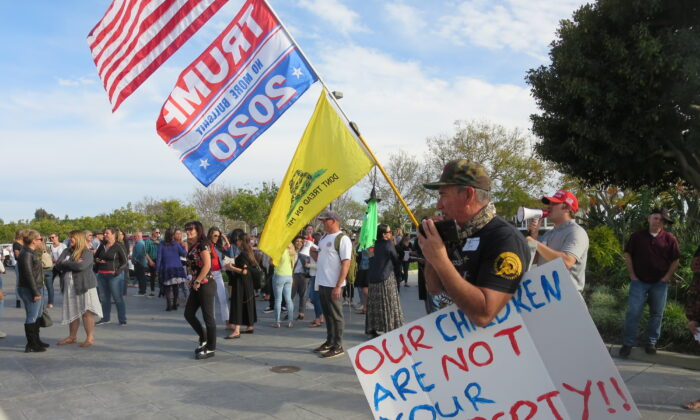 Parents rally outside the Orange County Department of Education in Costa Mesa, Calif. April 7, 2021. (Mei Li/The Epoch TImes)