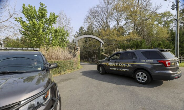 A York County sheriff vehicle on April 8, 2021, drives onto a property where multiple people, including a prominent doctor, were fatally shot a day earlier in Rock Hill, S.C. (Nell Redmond/AP Photo)