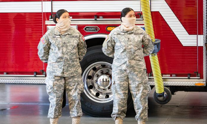 Sisters Ashley and Stephanie Roa await awards for heroism at OCFA Fire Station 61 in Buena Park, Calif., on April 8, 2021. (John Fredricks/The Epoch Times)