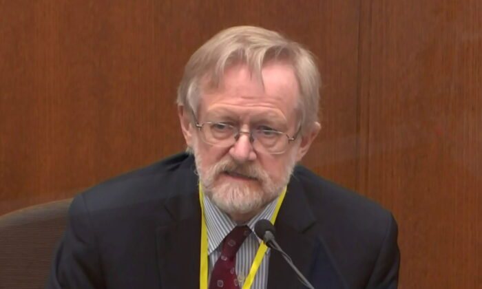 In a still image from video, Chicago-based breathing expert Dr. Martin Tobin answers questions during the ninth day of the trial of former Minneapolis police officer Derek Chauvin for second-degree murder, third-degree murder and second-degree manslaughter in the death of George Floyd in Minneapolis, Minn., on April 8, 2021. (Pool via Reuters)