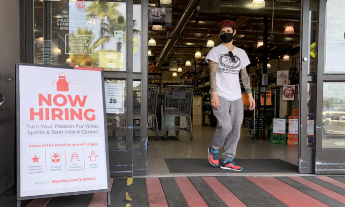 A customer walks by a now hiring sign at a BevMo store in Larkspur, Calif., on April 2, 2021. (Justin Sullivan/Getty Images)