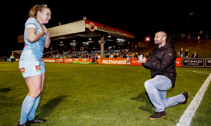 Matt Stonham proposing to Rhali Dobson after her final match at Frank Holohan Reserve in Melbourne, Australia, on March 25, 2021. (Darrian Traynor/Getty Images)
