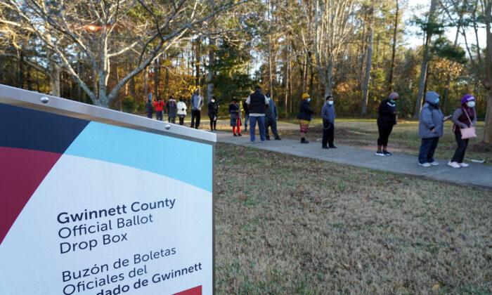 Voters stand in line to cast their ballots during the first day of early voting in the U.S. Senate runoffs at Lenora Park, in Atlanta, Ga., on Dec. 14, 2020. (Tami Chappell/AFP via Getty Images)