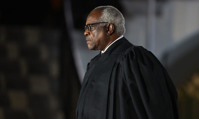 Supreme Court Associate Justice Clarence Thomas attends swearing-in ceremony for  Associate Justice Amy Coney Barrett on the South Lawn of the White House in Washington on Oct. 26, 2020. (Tasos Katopodis/Getty Images)