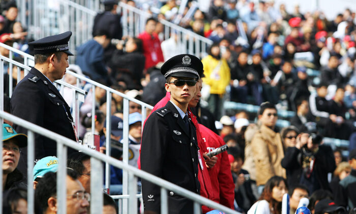Chinese policemen at the game between the Los Angeles Dodgers and the San Diego Padres at Beijing's Wukesong Stadium in Beijing, on March 16, 2008. (Guang Niu/Getty Images)