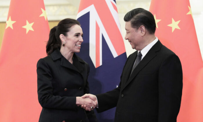 Chinese President Xi Jinping, right and New Zealand Prime Minister Jacinda Ardern, left shake hands before the meeting at the Great Hall of the People on April 1, 2019 in Beijing, China. (Kenzaburo Fukuhara - Pool/Getty Images)