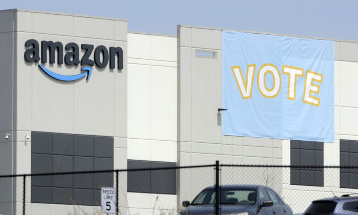 A banner encouraging workers to vote in labor balloting is shown at an Amazon warehouse in Bessemer, Alabama, oon March 30, 2021. (Jay Reeves/AP Photo)