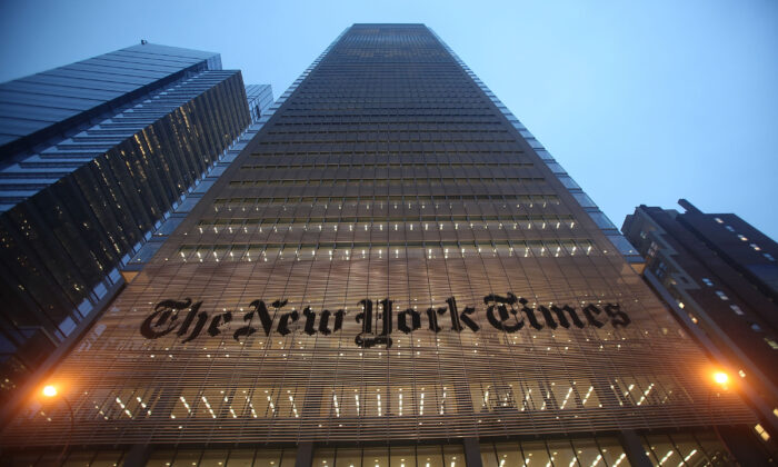 The New York Times' masthead is displayed in front of the midtown headquarters in New York City on Dec. 7, 2009. (Mario Tama/Getty Images)