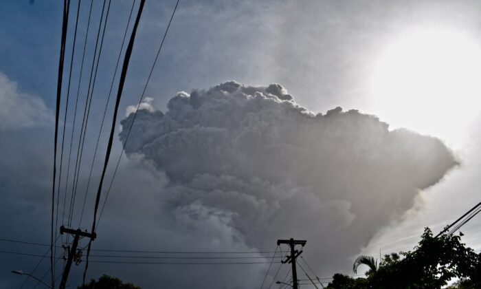 Ash rises into the air as La Soufriere volcano erupts on the eastern Caribbean island of St. Vincent, seen from Chateaubelair on April 9, 2021. (Orvil Samuel/AP Photo)