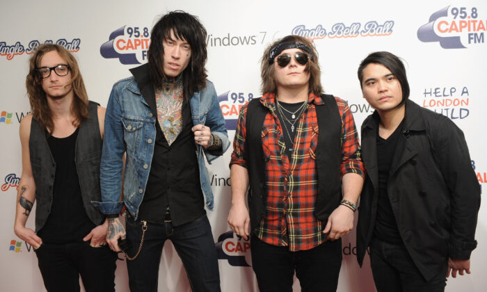 (L-R) Blake Healy, Trace Cyrus, Mason Musso and Anthony Improgo of 'Metro Station' attend the Capital FM Jingle Bell Ball - Day 2 at 02 Arena in London, England on Dec. 6, 2009. (Ian Gavan/Getty Images)