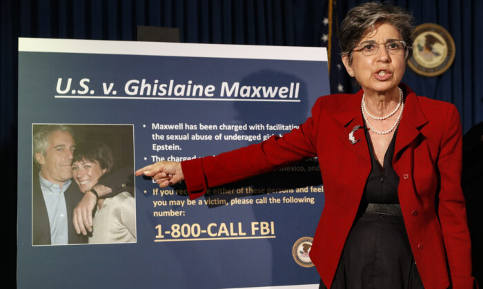 Audrey Strauss, Acting United States Attorney for the Southern District of New York, points to a photo of Jeffrey Epstein and his ex-girlfriend Ghislaine Maxwell, on July 2, 2020. (John Minchillo/AP Photo)