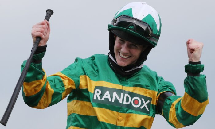 Jockey Rachael Blackmore celebrates winning the Grand National riding Minella Times at Aintree Racecourse in Liverpool, UK, on April 10, 2021. (Scott Heppell/Pool via Reuters)