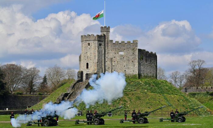 Members of the 104th Regiment Royal Artillery fire a 41-round gun salute in the grounds of Cardiff Castle, to mark the death of Prince Philip, in Cardiff, on Apr. 10, 2021. (Ben Birchall/PA via AP)
