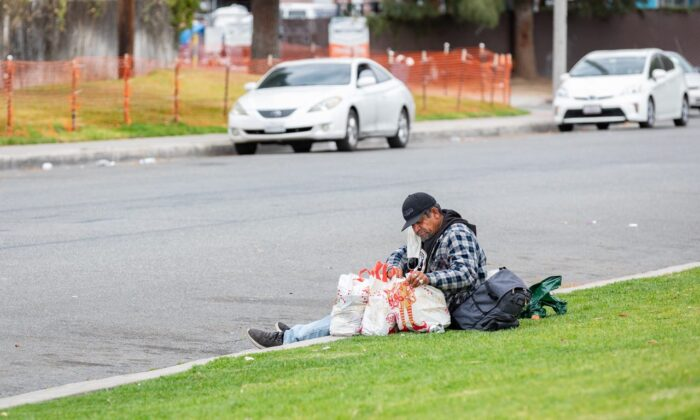A homeless man rests near Orange, Calif. (John Fredricks/The Epoch Times)