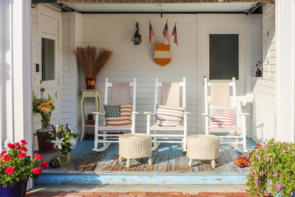 Fireman,And,Patriotic,Themed,Worn,Wooden,Front,Porch,In,Cape