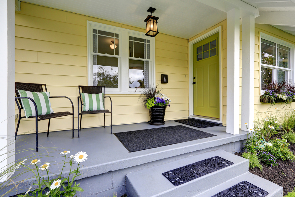 Small,American,Yellow,House,Exterior.,Covered,Porch,With,Stairs.,Northwest,