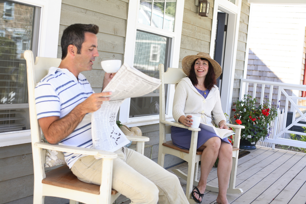 Couple,Sitting,On,Front,Porch