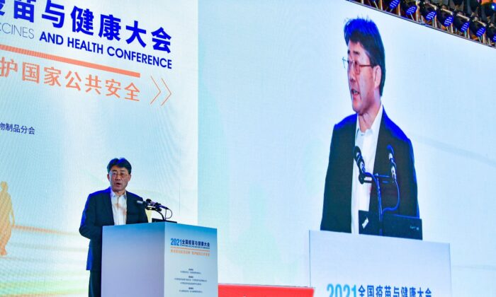 Gao Fu, director of the China Centers for Disease Control, speaks at the National Vaccines and Health conference in Chengdu in southwest China's Sichuan Province on April 10, 2021. In a rare admission of the weakness of Chinese coronavirus vaccines, Gao the country's top disease control official says their effectiveness is low and the government is considering mixing them to give them a boost. (Chinatopix Via AP)