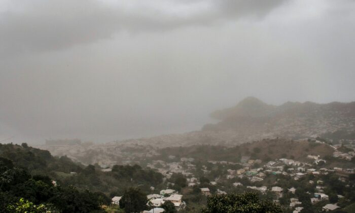 A cloud of volcanic ash hovers over Kingstown, on the eastern Caribbean island of St. Vincent, on April 10, 2021, a day after the La Soufriere volcano erupted. (Lucanus Ollivierre/AP)