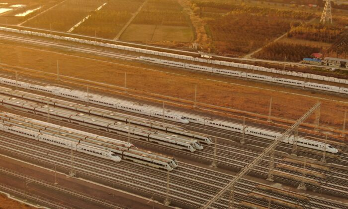 An aerial view of bullet trains on the newly built high-speed railways in Nantong, eastern China's Jiangsu Province on Dec. 15, 2020. (STR/AFP via Getty Images)