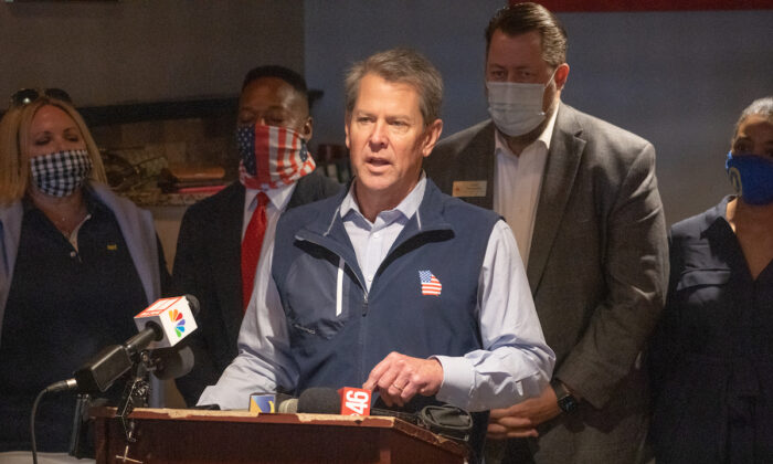 Georgia Gov. Brian Kemp speaks at a news conference about the state's new Election Integrity Law that recently passed at AJ's Famous Seafood and Poboys in Marietta, Ga., on April 10, 2021. (Megan Varner/Getty Images)