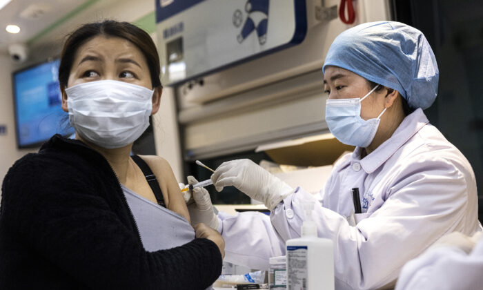 A woman receives the COVID-19 vaccine on the move vaccination vehicle in Wuhan, China on April 8, 2021. (Getty Images)