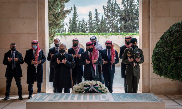 Jordan's King Abdullah II, center, Prince Hamzah bin Al Hussein, second left, and others during a visit to the tomb of the late King Hussein, in Amman Jordan, on April 11, 2021. (Royal Court Twitter Account via AP)