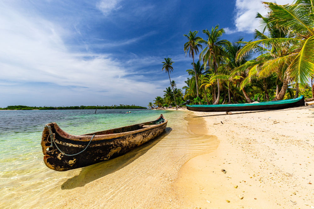 Dugout,Canoes,On,Beautiful,Sand,Beach,On,San,Blas,Islands,