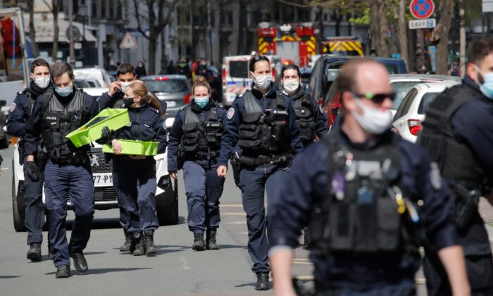 Police officers leave the scene after a shooting in Paris, France, on April 12, 2021. (Christophe Ena/AP Photo)