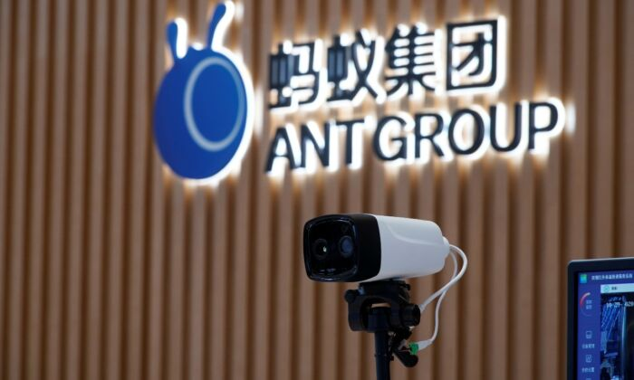 A thermal imaging camera is seen in front of a logo of Ant Group at the headquarters of Ant Group, an affiliate of Alibaba, in Hangzhou, China on Oct. 29, 2020. (Reuters/Aly Song/File Photo)