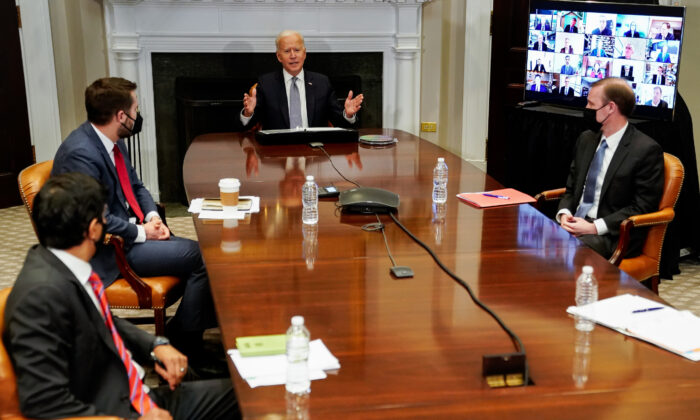 President Joe Biden (C) speaks during a CEO Summit on Semiconductor and Supply Chain Resilience via video conference with National Economic Council Director Brian Deese (2nd L), National Security Advisor Jake Sullivan (R) and others from the Roosevelt Room at the White House on April 12, 2021 in Washington. (Amr Alfiky-Pool/Getty Images)