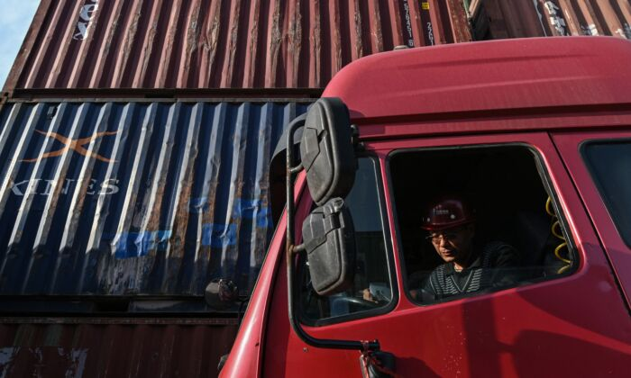 A trucker waits his turn to unload a container at the Lianyungang Port Container Terminal in Lianyungang, eastern China's Jiangsu Province on March 24, 2021. (Hector Retamal/AFP via Getty Images)