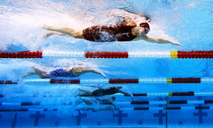 Abbey Weitzeil leads in the Women's 100-Meter Freestyle Final on day four of the TYR Pro Swim Series at Marguerite Aquatics Center in Mission Viejo, Calif., on April 11, 2021.  (Maddie Meyer/Getty Images)