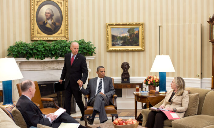 Vice President Joe Biden (Center L) arrives for a meeting with President Barack Obama, Secretary of State Hillary Clinton, and National Security Adviser Tom Donilon in the Oval Office in Washington on July 18, 2012. (Pete Souza/White House Photo via Getty Images)