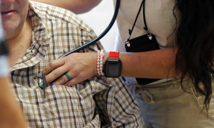 A man receives medical treatment in a file photo taken in Florida. (Gerald Herbert/File/AP Photo)