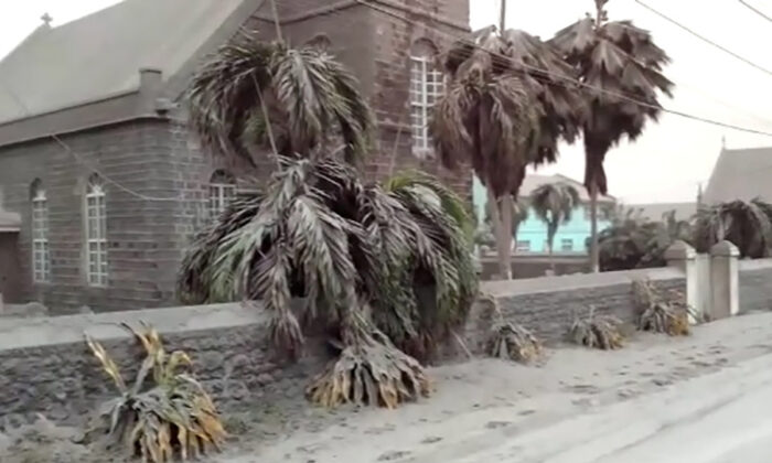 Ash covers palm trees and a church in a still image from video a day after the La Soufriere volcano erupted after decades of inactivity, about 5 miles (8 km) away in Georgetown, St Vincent and the Grenadines, on April 10, 2021. (Robertson S. Henry via Reuters)