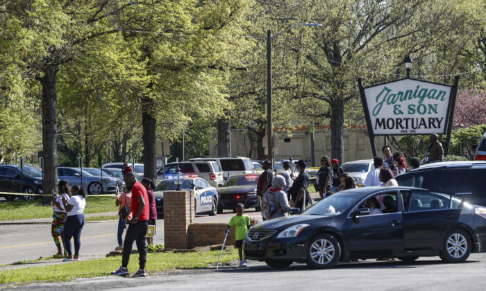 People gather outside Austin-East Magnet High School in Knoxville, Tenn., following a shooting at the school on April 12, 2021. (Wade Payne/AP Photo)